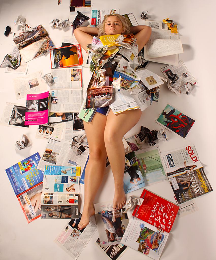 girl and newspapers